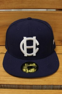 "This 59FIFTY® fitted cap is one of two official on-field caps for the HarbourCats. It features an embroidered (raised) white ""HC"" logo on the front, stitched New Era® flag at wearer's left side and embroidered maple leaf on the rear."