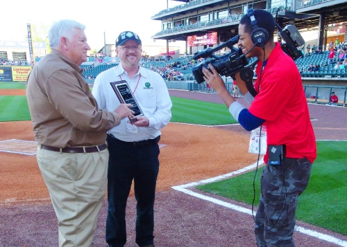 Joe Mock presents the 2013 BaseballParks.com Ballpark of the Year Award to Don Logan, one of the owners of the Barons.