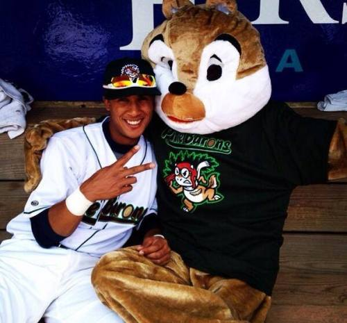 ne Barons mascot Chipper and Pine Barons SS Enmanuel Serra in the dugout before the game, Lakewood BlueClaws Facebook photo