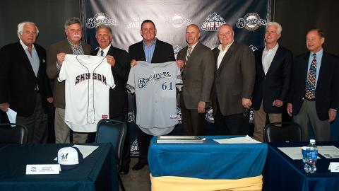 Members of the Colorado Springs Sky Sox and Milwaukee Brewers Front Office hold team jerseys following the signing of a two-year Player Development Contract at Security Service Field. (Paat Kelly)