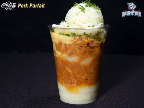 "The ""Pork Parfait"" featuring layers of mashed potatoes, pulled pork and cheese sauce topped with green onions, Lehigh Valley IronPigs graphic"