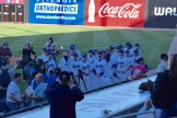 The St. Paul Saints players gather around the home dugout.