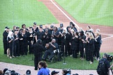 "Robert Robinson and choir sing ""When the Saints Go Marching In"" at home plate to kick off inaugural festivities."