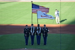 The U.S. Army color guard presents the flag for the inaugural singing of the national anthem at CHS Field.
