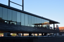 An exterior view of the glassy Securian Club at CHS Field.