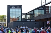 The Opening Day crowd gathers on the plaze outside the main-gate entrance to CHS Field.