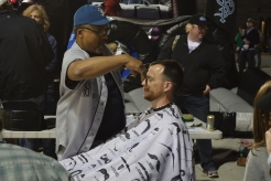 A fan gets a trim from barber Bilal Saleem (AKA Mr. B). Now, where is our favorite massage therapist, Sister Rosalind Gefre?