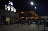 A night view of the big CHS Field sign, concourse, and Securian Club porch.
