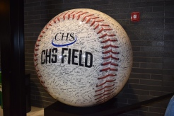 A giant baseball sporting its signatures under the covered concourse at CHS Field.