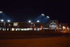 A night view of CHS Field across the corner from the School of Rock.