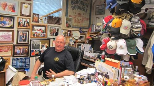 Peter Bragan envisions turning his baseball memorabilia-filled office into a local museum. (Benjamin Hill/MiLB.com)