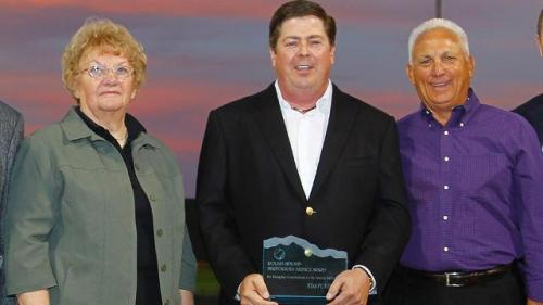 Tim Purpura (center) was given the Roland Hemond Award by the Arizona Fall League back in 2010. (Jordan Megenhardt)